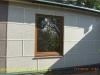фото дома, фасад защищен панелями с мраморной крошкой 03