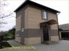 фото дома, фасад защищен панелями с мраморной крошкой 10