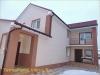 фото дома, фасад защищен панелями с мраморной крошкой 15