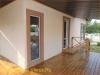 фото дома, фасад защищен панелями с мраморной крошкой 20