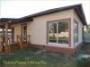 фото дома, фасад защищен панелями с мраморной крошкой 21