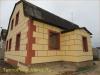 фото дома, фасад защищен панелями с мраморной крошкой 22