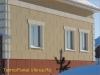 фото дома, фасад защищен панелями с мраморной крошкой 26