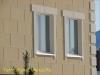 фото дома, фасад защищен панелями с мраморной крошкой 27