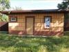 фото дома, фасад защищен панелями с мраморной крошкой 33